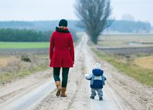 Mother and child on sandy road Royalty Free Stock Photos