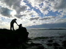 Mother and Child at the Sea. Silhouette of mother and child at the beach Stock Image
