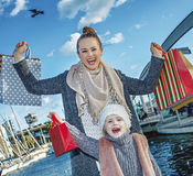 Mother and child with shopping bags in Barcelona rejoicing Royalty Free Stock Image