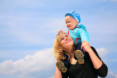 Mother with child on shoulders Royalty Free Stock Image