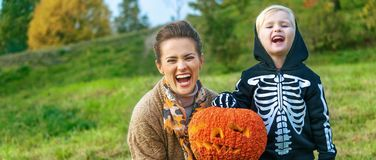 Mother and child showing Halloween pumpkin Jack O'Lantern Stock Photo