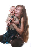 Mother with the child sing. In a microphone on a white background stock image