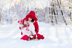 Mother and child sledding. Winter snow fun. Family on sleigh. Mother and baby on sleigh ride. Child and mom sledding. Toddler kid riding sledge. Children play Stock Photos