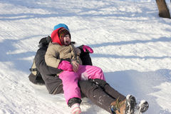 Mother and child sledging Royalty Free Stock Photo