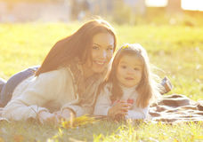 Mother and child smiling having fun in sunny autumn Stock Image