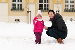Mother and child in snow Stock Images
