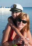 Mother and the child (son) on a beach. In summer day stock photography