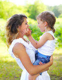Mother with child son having fun outdoors in summer Royalty Free Stock Photography