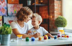 Mother and child son  painting draws in creativity in kindergarten. Mother and child son  painting draws are engaged in creativity in kindergarten stock photography