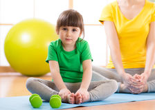 Mother and child spending time doing fitness. Mother and child girl spending time doing fitness Stock Image
