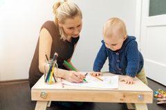 Mother and child spending time together and drawing Stock Image