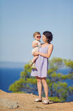 Mother and Child Standing on Hill Royalty Free Stock Photos