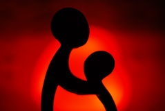 Mother and child. Statue on red light heart lamp light Stock Photo