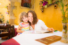 Mother and child in summer cafe Stock Image