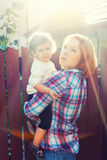 Mother child sun rays royalty free stock photography
