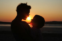 Mother and child on sunset Stock Image