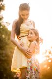 Mother and child at sunset Royalty Free Stock Photos