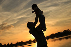 Mother and child on sunset. Silhouette Royalty Free Stock Images