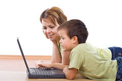 Mother and child surfing the net together Royalty Free Stock Image
