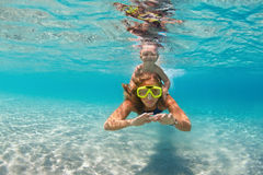 Mother with child swim underwater with fun in sea. Happy active family - mother, baby son snorkel and dive together underwater in sea pool. Healthy people Royalty Free Stock Photos