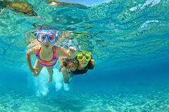 Mother with child swim underwater with fun in sea Royalty Free Stock Photography