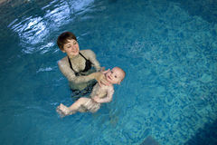 Mother and child swimming Stock Photos