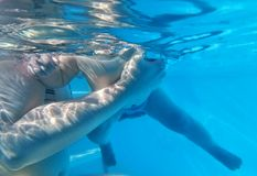 Mother with child swimming Stock Image