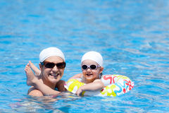 Mother with child in swimming pool Royalty Free Stock Image