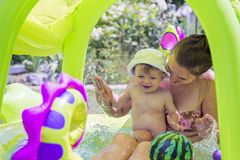 Mother and child swimming in the pool. Little kid learning and exercising in the water.  stock photography