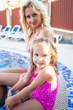 Mother and child at the swimming pool stock image