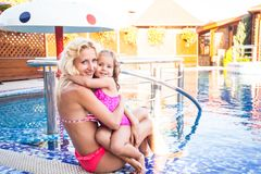Mother and child at the swimming pool stock photo