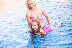 Mother and child at the swimming pool Royalty Free Stock Image
