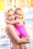 Mother and child at the swimming pool Royalty Free Stock Photo