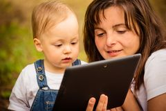 Mother, child and tablet Royalty Free Stock Image