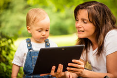 Mother, child and tablet Royalty Free Stock Images