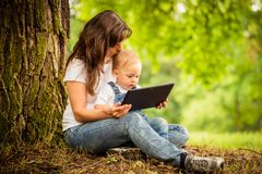 Mother, child and tablet Stock Image