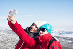 Mother and child take the selfie photo in winter landscape Royalty Free Stock Images