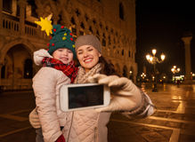 Mother and child taking selfie on Piazza San Marco in Venice Royalty Free Stock Photos