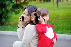 Mother and child talking on the phone Royalty Free Stock Photo
