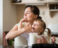 Mother and child tasting whipping cream Royalty Free Stock Image
