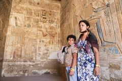 Mother with child at temple - Egypt Stock Images
