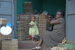 Mother and child in there shop selling eggs. Stock Photos