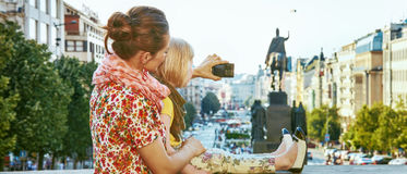 Mother and child tourists with camera taking photo in Prague Stock Photos