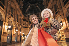 Mother and child tourists with Christmas shopping bags in Milan Stock Image