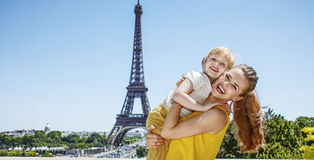 Mother and child tourists embracing in front of Eiffel tower Royalty Free Stock Images