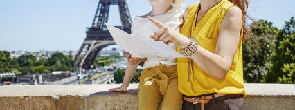 Mother and child tourists holding map and pointing. Paris Royalty Free Stock Photo