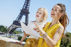 Mother and child tourists holding map and pointing. Paris Royalty Free Stock Photography