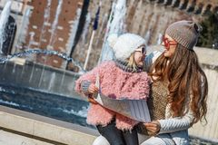 Mother and child tourists near Sforza Castle having excursion Royalty Free Stock Photos