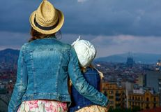 Mother and child travellers in Barcelona looking into distance Stock Photography