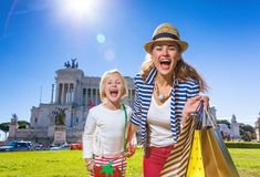 Mother and child travellers in front of Palazzo Venezia shopper. Roman Holiday. Portrait of smiling modern mother and child travellers in the front of Palazzo royalty free stock images